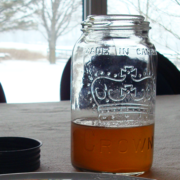 Glass jar of maple syrup made in Canada