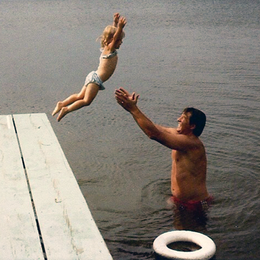 My Dad catching me as I jump into the lake