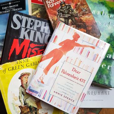 Dear Fahrenheit 451 on top of a pile of books