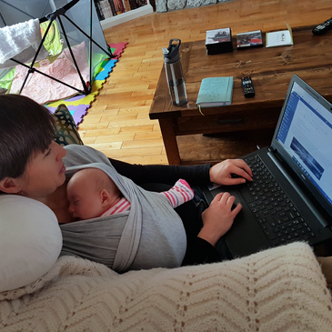 Working while wearing the baby in a carrier